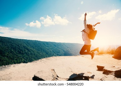 young woman Jumping  at mountain view  for sun light