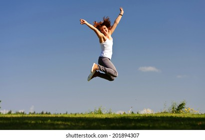 Young woman jumping outside