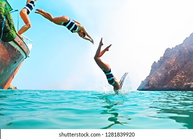 Young woman jumping from a sailing boat. One model. Summertime, travel and holiday concept. Picture made from three shot