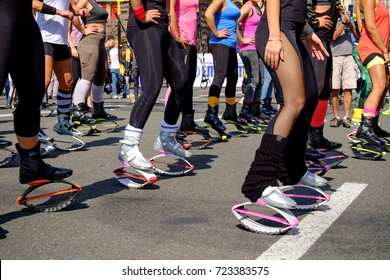 young woman in Kangoo jumps shoes