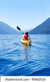 Young woman kayaking on Lake Crescent, Olympic National Park, Washington, USA