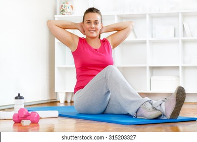 Young woman keeping healthy and fit after child birth.