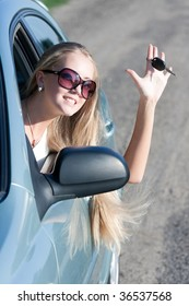 young woman with keys of the car