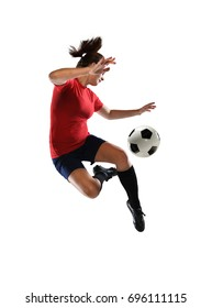 Young woman kicking soccer ball with heel isolated over white background