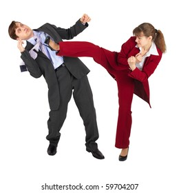 The young woman kicks the man in a business suit