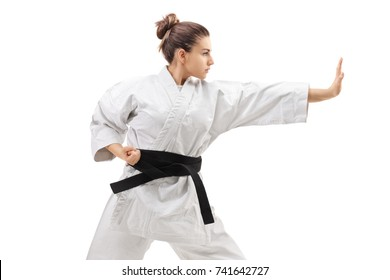 Young woman in a kimono practicing karate isolated on white background