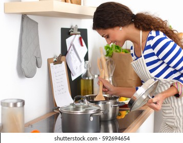 Young woman in the kitchen preparing a food