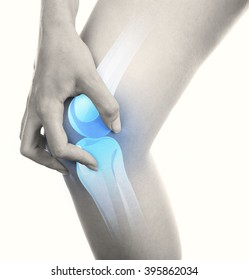 Young woman with knee pain isolated on white