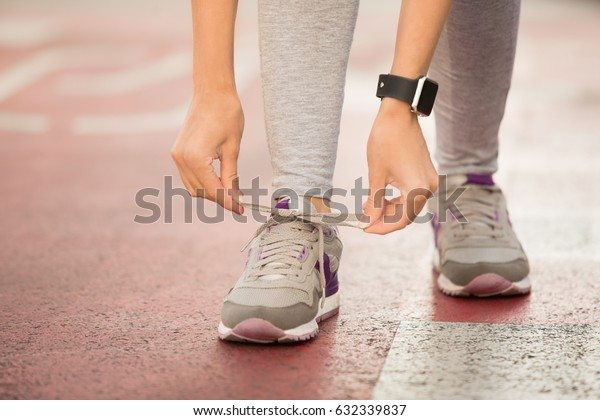Young woman lace up snickers healthy sporty lifestyle