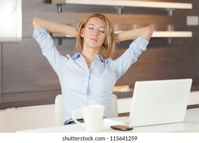young woman with laptop - Shutterstock ID 115641259