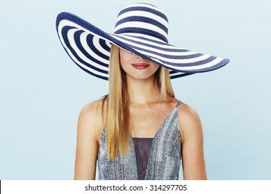 Young woman in large wide brimmed hat
