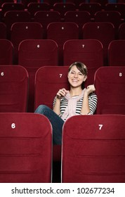 Young woman laughing at funny scene