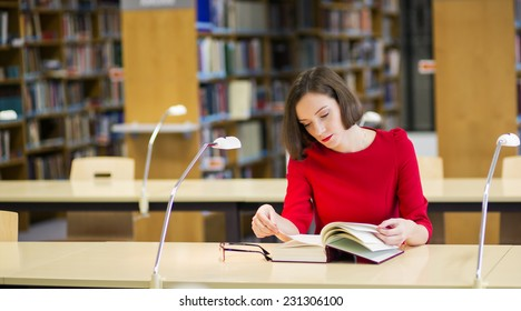 Young woman leaf through fat book without glasses