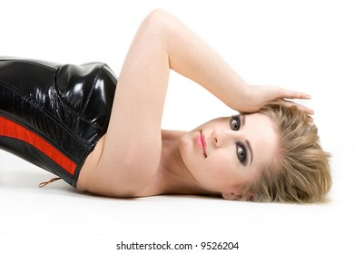 Young woman leaning on her back in corset