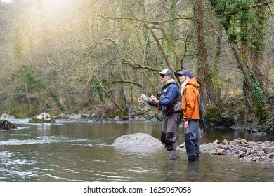 young woman learning to fly fishing with a guide