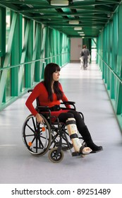 young woman with leg in plaster and wheelchair in the hospital
