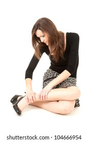young woman with legs pain, full length, white background