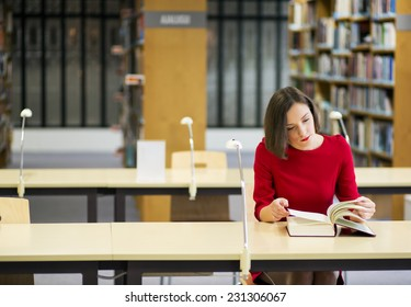 Young woman in library seek knowledge from book