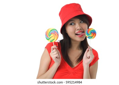 Young woman licking on lollipop