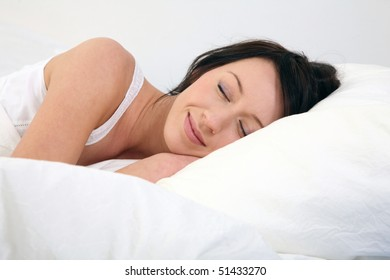young woman lies in bed and sleep