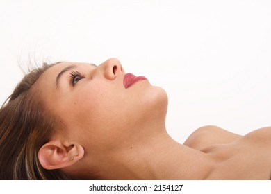 A young woman lies on her back, ready to begin her spa treatment.