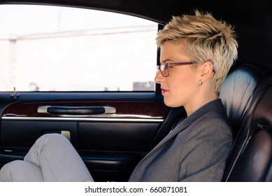 Young woman in limousine