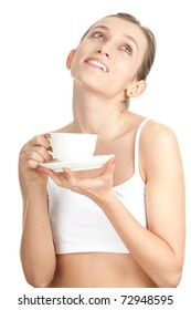 young woman in lingerie drinking coffee with great pleasure