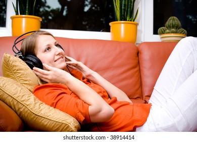 young woman listen to the music with head phones