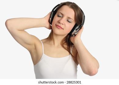 Young woman listen music in headphones
