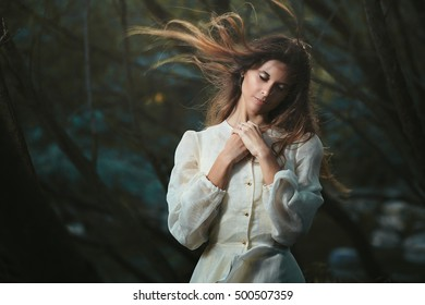 Young woman listening her inner voice . Romantic and surreal