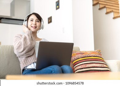 Young woman listening music with digital  devices.  Music streaming service.