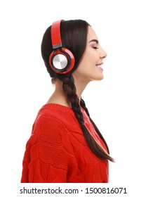 Young woman listening to music with headphones on white background