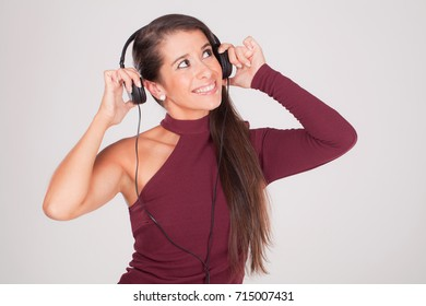 young woman listening to music on headphones