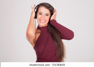 young woman listens to music on headphones