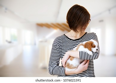Young woman with little Cavalier King Charles Spaniel dog