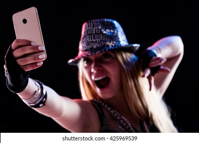 young woman living a live event online using some internet connection or service via her smartphone and feeling as like as if she was really there