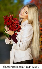 young woman with long blond hair in autumn color