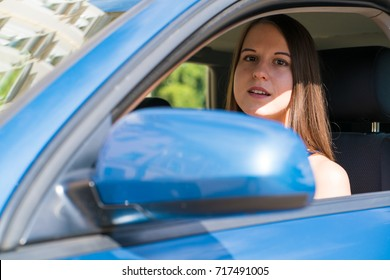 Young woman with long hair in car