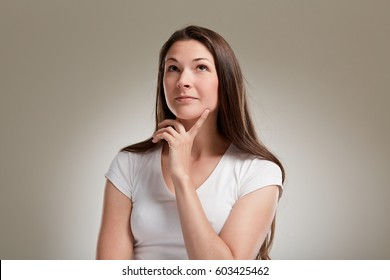 Young woman with long hair, thinking about something