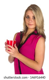 Young woman looking at camera with coffee cup she is holding isolated on white