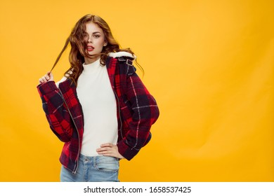 young woman looking at the camera with her hair isolated background