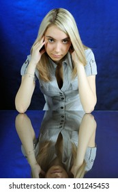 The young woman looking at camera. On a dark blue background.