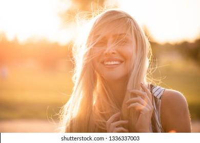 Young woman looking at camera, stylish shot.