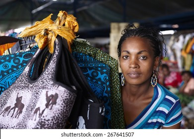 Young woman, looking at the camera, working in a street market in Nairobi (Kenya)