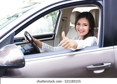 Young woman looking from car window