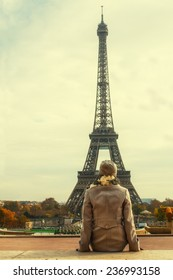Young woman looking at Eiffel Tower in Paris