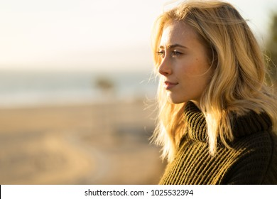 Young woman looking far away