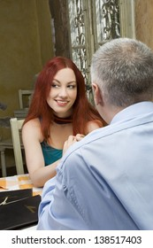 Young woman looking and flirting with another - Glance over his shoulder - Restaurant scene - Selective focus