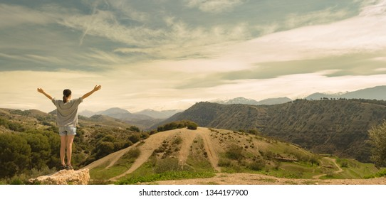 Young woman looking forward to reach the Sierra Nevada Mountain peak in southern Spain