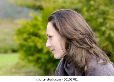 Young woman looking at green nature
